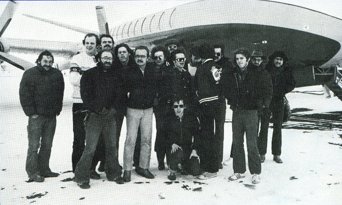 Queen crew in front of Queen's private plane in USA 1978