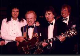 Guest appearance: Brian May live at the Grosvenor House Hotel, London, UK (Water Rats Ball with Phil Collins, Dec Cluskey, Joe Brown, Lonnie Donnegan, George Harrison and Bert Weedon)